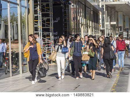 People Walk Along The Zeil In Midday In Frankfurt, Germany