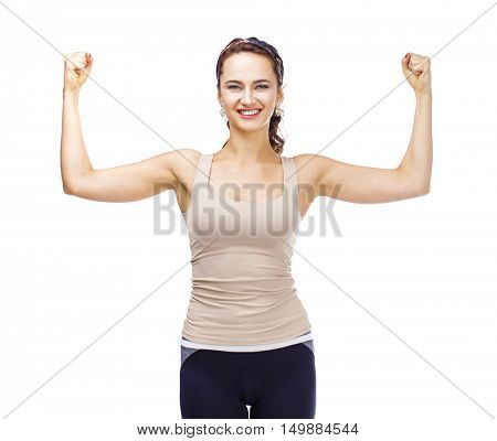 Strength of a woman in her weakness. Strong and muscular young woman showing her muscles, isolated on white background