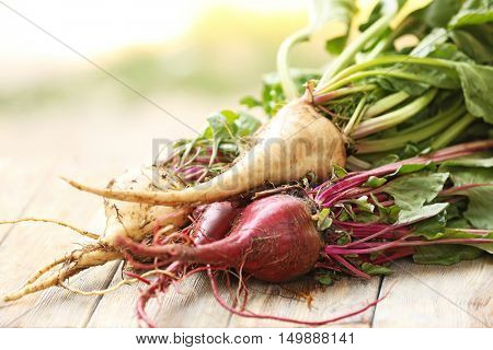 Bunch of young beets on wooden background