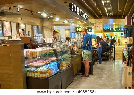 SINGAPORE - CIRCA SEPTEMBER, 2016: Starbucks at Singapore Changi Airport. Starbucks Corporation is an American coffee company and coffeehouse chain.