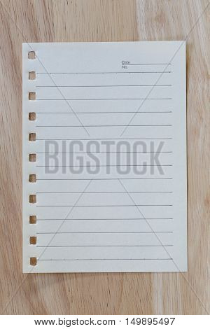 vintage of note paper on wooden background and copy specs you can input text to it.