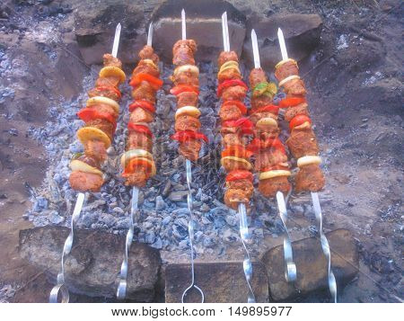 Shish kebab on skewers on a makeshift grill