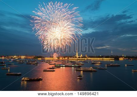 Fireworks over Neva river, ships, Peter and Paul fortress in Saint Petersburg, Russia in evening
