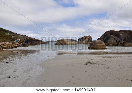 DENMARK,WA,AUSTRALIA-OCTOBER 2,2014: Remote beach at Elephant Cove with tourists and rounded granite formations on a cloudy day in Denmark, Western Australia.