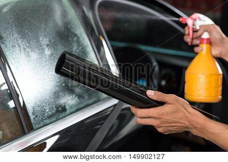 Car window tinting series : Spraying water on window