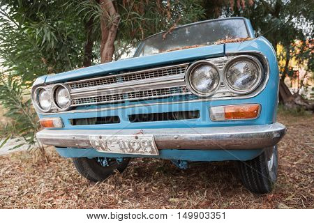 Close Up Front View Of Blue Datsun 1300 Pickup