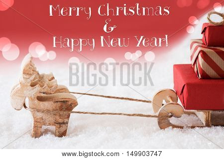 Moose Is Drawing A Sled With Red Gifts Or Presents In Snow. Christmas Card For Seasons Greetings. Red Christmassy Background With Bokeh Effect. English Text Merry Christmas And Happy New Year