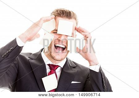 Mental Overload - Office Worker With Post-its All Over His Face..