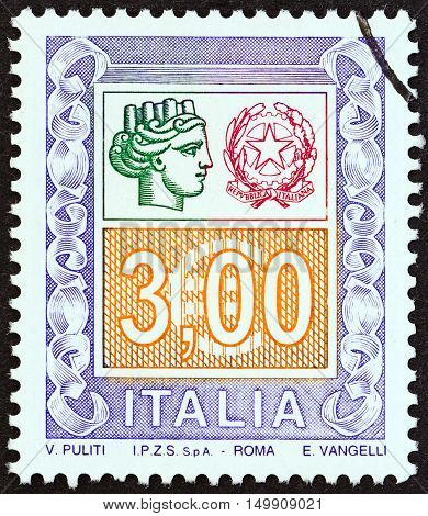 ITALY - CIRCA 2004: A stamp printed in Italy shows ornaments and Italy turreted, circa 2004.