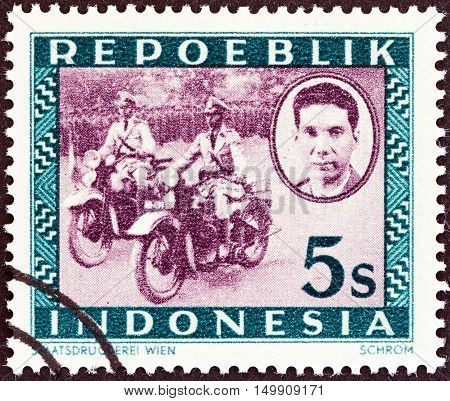 INDONESIA - CIRCA 1947: A stamp printed in Indonesia shows Motorized police, Ali Sastroamidjojo (1903-1976), circa 1947.