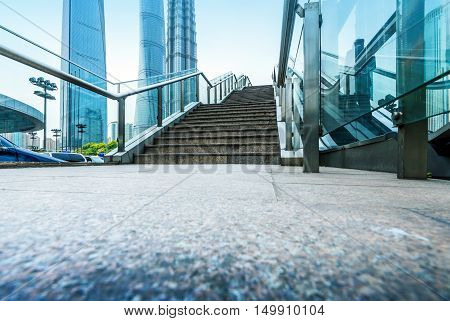 Shanghai streets, escalators and stairs next to the buildings
