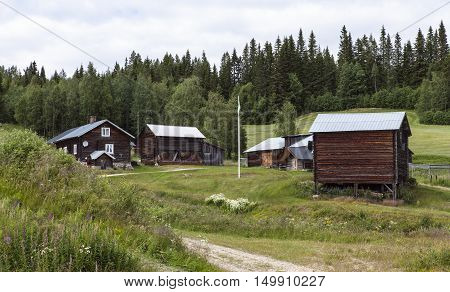 HARJEDALEN, SWEDEN ON JULY 07. View of an old wooden homestead on July 07, 2016 in Harjedalen, Sweden. Rural place in the landscape, countryside. Editorial use.