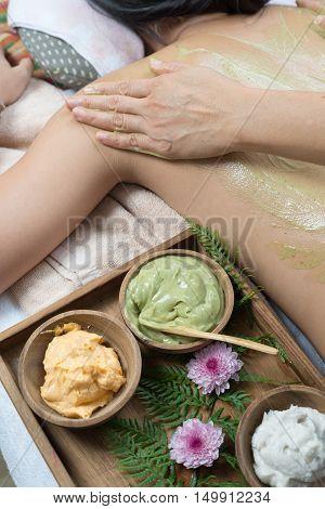 Massage series : Therapist massaging woman's back with green tea scrub