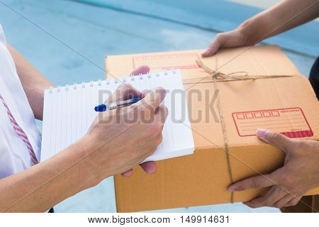 Delivery service sent to customer receiving package box.