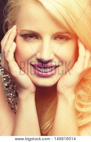 Beautiful blue eyes blond woman smiling