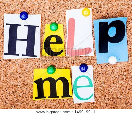 The Phrase Help Me In Cut Out Magazine Letters Pinned To A Cork Notice Board..