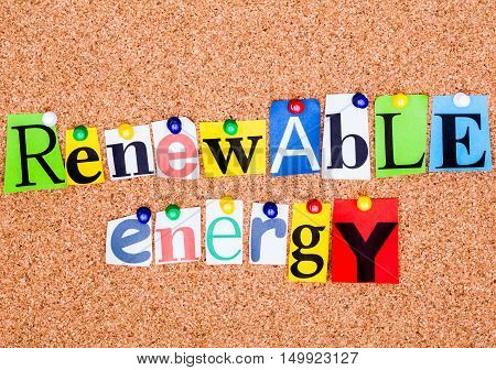 The Phrase Renewable Energy In Cut Out Magazine Letters Pinned To A Cork Notice Board..