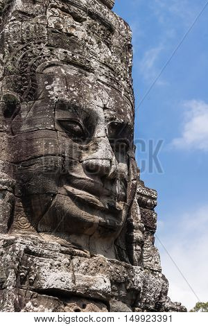 Towers with faces in Angkor Wat temple complex in Cambodia and the largest religious monument in the world. UNESCO World Heritage Site.