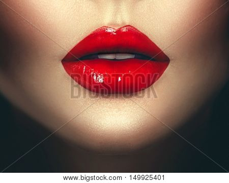 Sexy Woman lips with red lipstick. Fashion Glamour art design. Closeup of glamourous girl  mouth close-up on dark background. Passion
