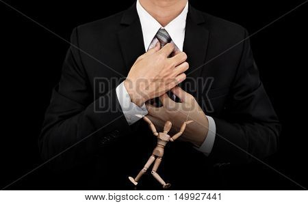 Businessman with wooden figure puppet, concept of business manipulation