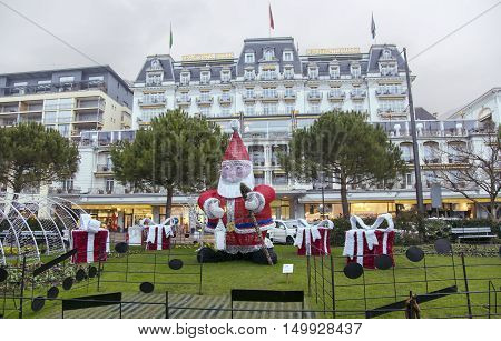 SWITZERLAND, MONTREUX, DECEMBER, 28, 2015 - Beautiful Christmas decorations on the background of the Grand hotel Suisse Majestic in Montreux, Switzerland