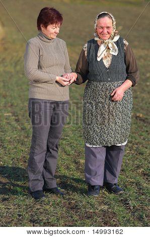 Daughter Help Elderly Mother Walk