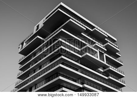 Angled Image of Modern Balconied High-Rise Building in Grayscale