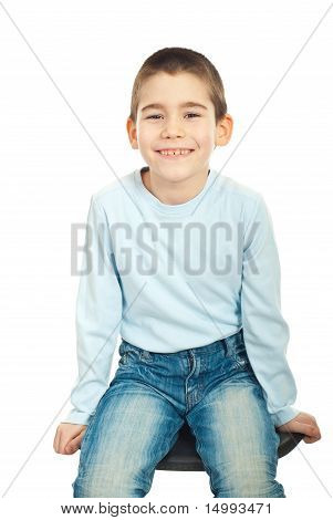 Happy Boy Sitting On Chair