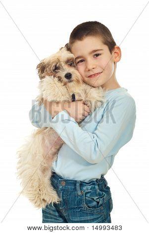 Happy Kid Holding His Puppy