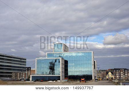 AARHUS DENMARK - SEPTEMBER 18 2016: New building with glass facade at the port of Aarhus- Aarhus will be European capital of culture in 2017. September 18 2016