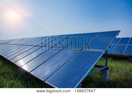 solar panels placed on a countryside meadow,china.