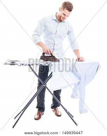 Happy Young Man Ironing On A Ironing Board, Isolated On White Background..