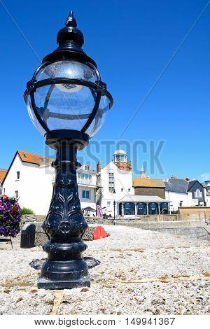 LYME REGIS, UNITED KINGDOM - JULY 18, 2016 - Black lantern on the promenade wall Lyme Regis Dorset England UK Western Europe, July 18, 2016.