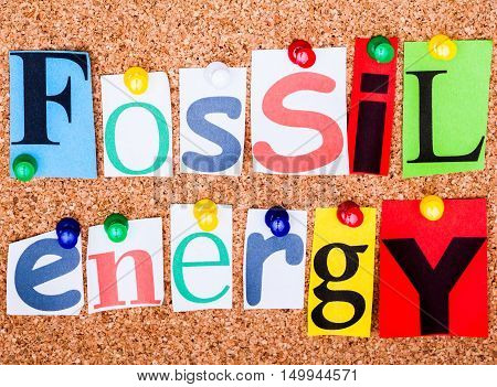 The Phrase Fossil Energy In Cut Out Magazine Letters Pinned To A Cork Notice Board..