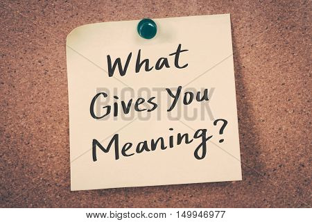 What gives you meaning? note message on a bulletin board
