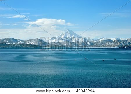 Volcano and sea in water in Russia on Kamchatka