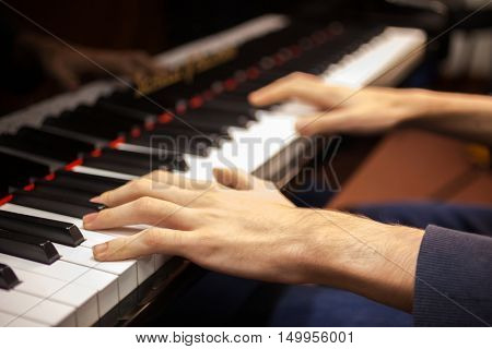 Closeup of a pianist playing his piano
