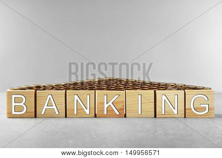 Wooden cubes with space for text on grey background