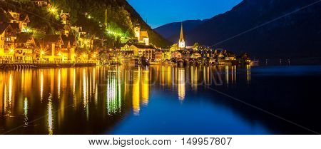 Classic view of Hallstatt village in Alps at dusk, Austria