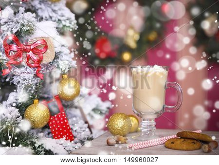 Hot cacao with marshmallows on a rustic table over Christmas background
