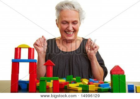 Senior Woman Playing With Building Blocks