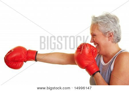 Senior Woman Learning How To Fight