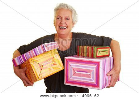 Senior Woman Carrying Many Presents