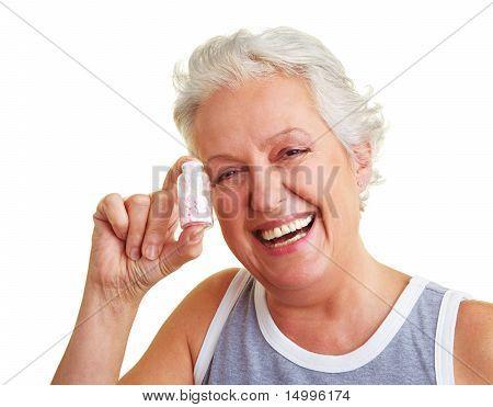 Happy Senior Woman Holding Pills