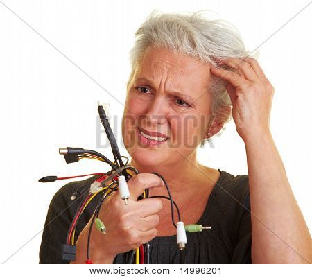 Senior Woman Looking At Cables