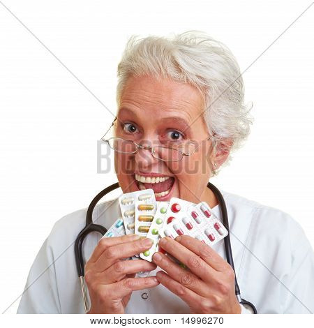 Female Doctor Eating Pills