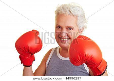 Happy Senior Woman Boxing