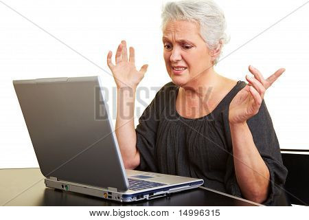 Desperate Senior Woman With Computer