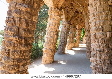 Stone columns in colonnade of Park Guell designed by Gaudi Barcelona Catalonia Spain