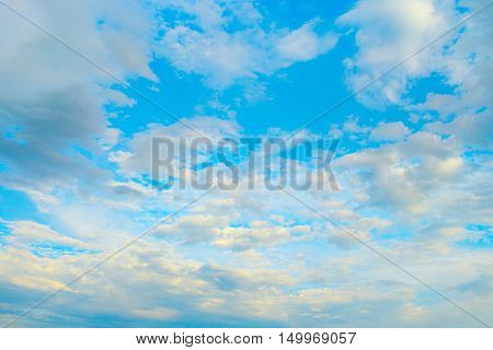 Light white clouds in blue sky. Heavenly landscape.